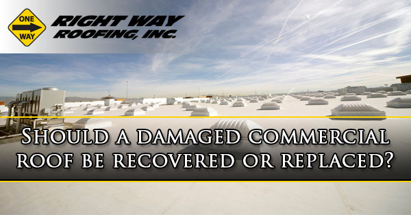 Should a damaged commercial roof be recovered or replaced?